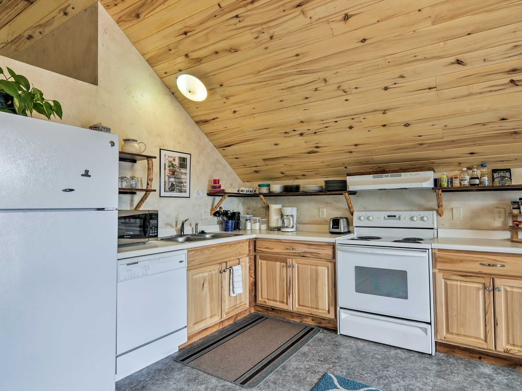 Sunrise Hollow's roomy, fully-stocked kitchen boasts a stove, fridge, microwave, and dishwasher for your cooking convenience.